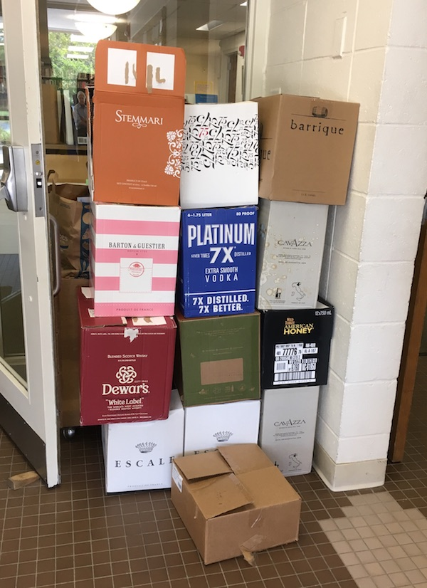 13 liquor boxes full of books